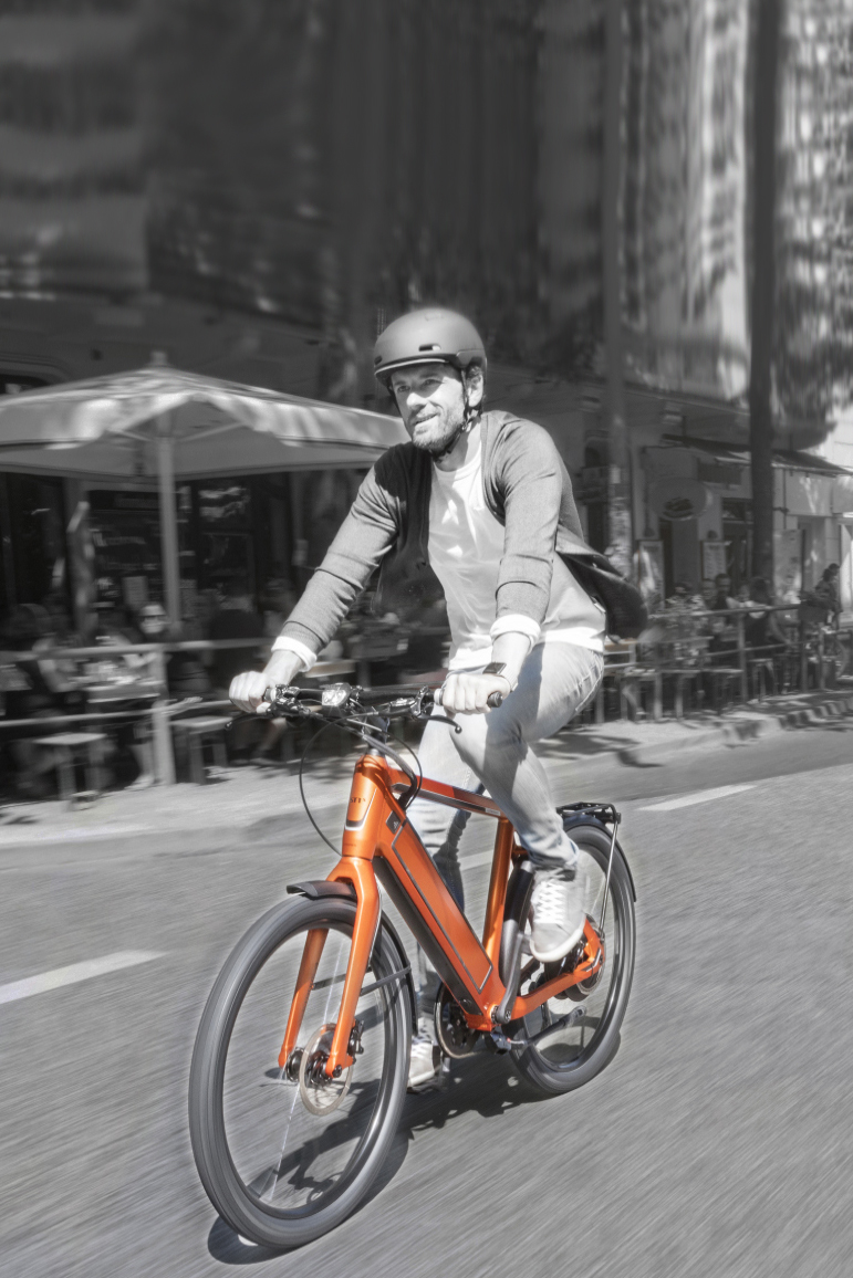 Man riding an e-bike in the city